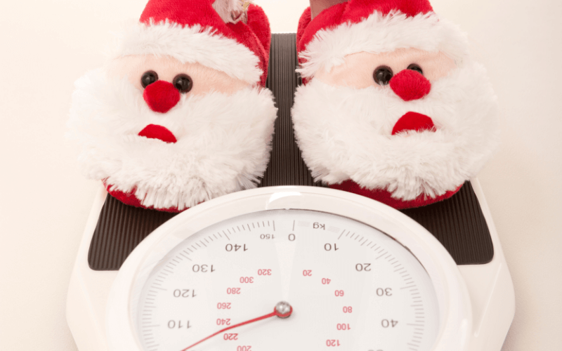 pair of santa slippers on a scale   avoid Christmas weight gain   goodMix