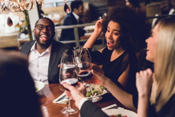group-young-people-drinking-wine-restaurant_85574-7807