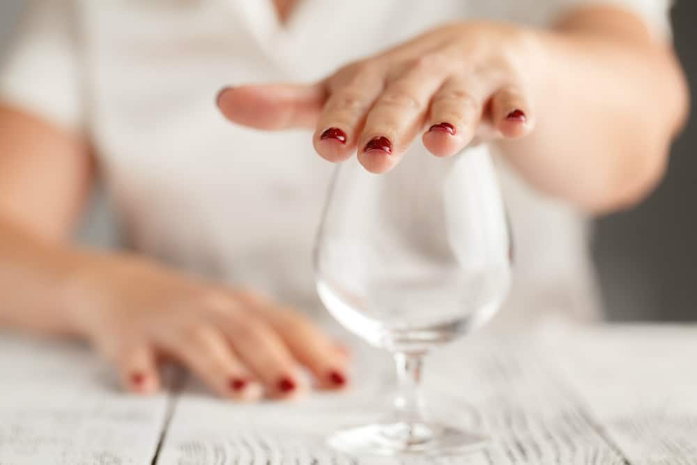 woman placing her hand over a glass | how to stop drinking naturally | goodMix