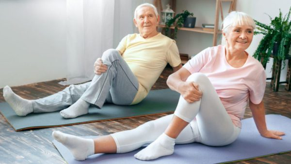 older man and woman exercising to increase vitality | goodMix