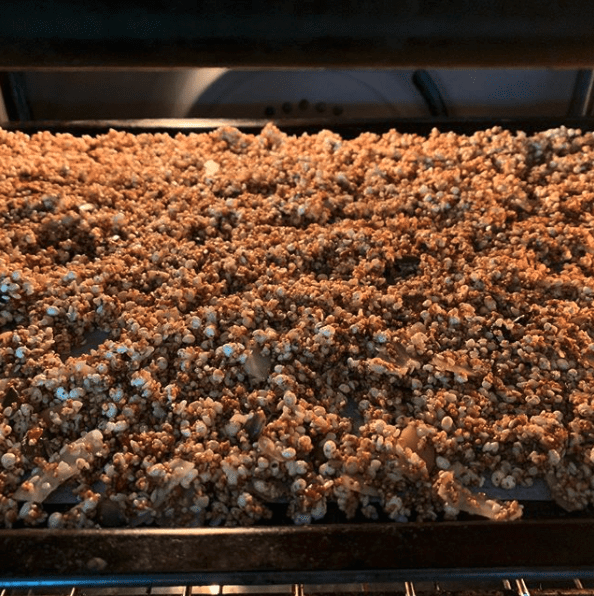 Gluten Free Sesame Crunch Granola toasting in oven | goodMix Superfoods