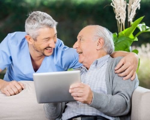 Older man chatting to middle aged man about natural factors for prostate health | goodMix